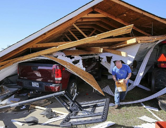 zac-farley-salvages-valuables-from-his-garage-monday-after-a-tornado-destroyed-the-structure-at-his-home-on-needs-creek-drive-in-springhill