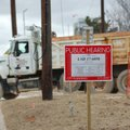 Construction crews go in and out Monday at the site of the future Pinnacle Foods Inc. expansion at 1...