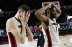Georgia forwards Mike Edwards, left, and Yante Maten react after the team's 80-77 loss to Arkansas in two overtimes in an NCAA college basketball game in Athens, Ga., Tuesday, Jan. 23, 2018. (Joshua L. Jones/Athens Banner-Herald via AP)