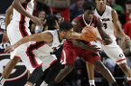 Georgia guard Juwan Parker (3) knocks the ball out of the hands of Arkansas guard Jaylen Barford (0) in overtime of an NCAA college basketball game in Athens, Ga., Tuesday, Jan. 23, 2018. (Joshua L. Jones/Athens Banner-Herald via AP)