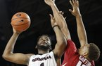 Georgia forward Yante Maten (1) looks for a shoot while defended by Arkansas forward Daniel Gafford (10) during the second half of an NCAA college basketball game in Athens, Ga., Tuesday, Jan. 23, 2018.