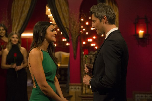 tia-booth-talks-with-arie-luyendyk-in-this-photo-from-the-premiere-of-this-seasons-the-bachelor