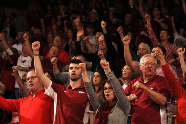 Arkansas fans celebrate during the first half of the Razorbacks' 85-67 win against Georgia on March 4, 2017, in Bud Walton Arena in Fayetteville.