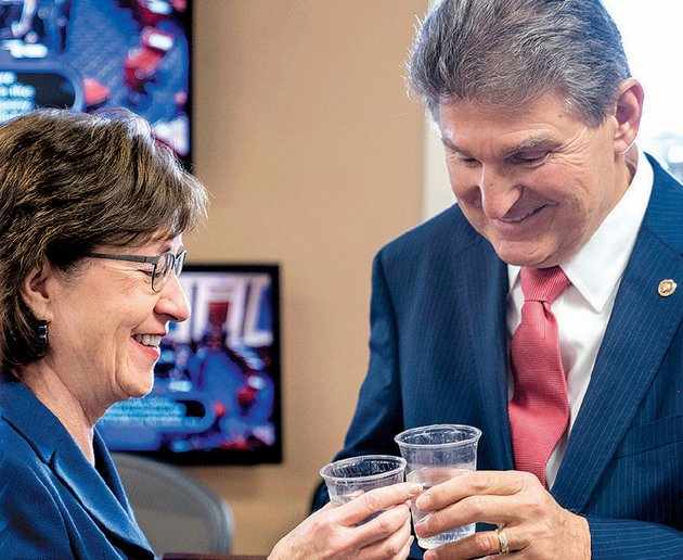 sens-susan-collins-r-maine-and-joe-manchin-d-wva-toast-each-other-as-they-wait-to-speak-at-a-news-conference-on-capitol-hill-on-monday-in-washington-after-senators-reached-an-agreement-to-advance-a-bill-ending-the-government-shutdown
