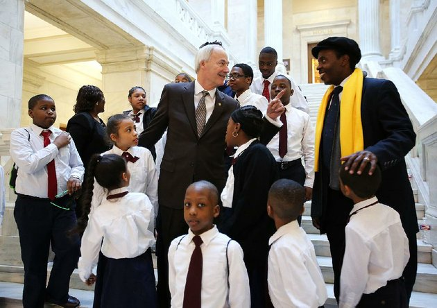 arkansas-gov-asa-hutchinson-center-talks-to-pastor-aaron-agnew-director-of-word-of-outreach-christian-academy-after-posing-for-a-photo-with-academy-students-wednesday-during-the-school-choice-rally-at-the-capitol
