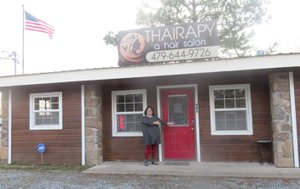 WESTSIDE EAGLE OBSERVER/Susan Holland Hilarie Dodd, owner of the Thairapy hair salon, welcomes visitors to her new location just south of the Hillcrest Cemetery in Gravette. Business hours are 10 a.m. to 6 p.m. Monday through Friday and 9 a.m. to 2 p.m. Saturday. Dodd has planned an open house for Saturday, Feb. 10.