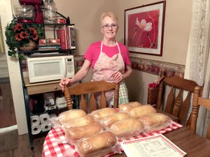 """Photo by Sally Carroll Linda """"Granny"""" Gill and her husband, Benton, have made lots of friends since she launched her baking business in mid-November. Granny is able to stay home and care for her husband while she bakes up a storm in the kitchen. She has gained a lot of customers in a short time, many of whom remember """"Granny"""" from her restaurant days, or when she served as a nutrition educator and traveled to schools in McDonald County. Some of her customers now are former students, she said, smiling."""