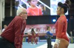 Arkansas gymnastics coach Mark Cook, left, talks with sophomore Jessica Yamzon during a meet against Kentucky on Friday, Jan. 12, 2018, at Barnhill Arena in Fayetteville.