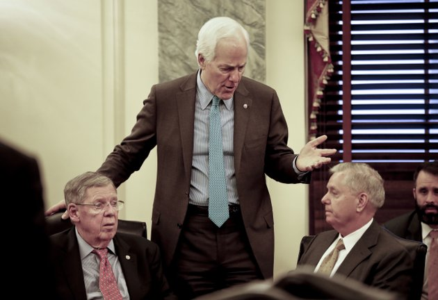 senate-majority-whip-sen-john-cornyn-r-texas-center-talks-with-sen-johnny-isakson-r-ga-left-and-sen-lindsey-graham-r-sc-right-before-the-start-of-a-meeting-on-immigration-wednesday-jan-24-2018-on-capitol-hill-in-washington-ap-photopablo-martinez-monsivais