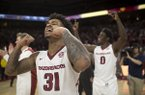 Arkansas guards Anton Beard (31) and Jaylen Barford (0) celebrate following the Razorbacks' 66-65 win over Oklahoma State on Saturday, Jan. 27, 2018, in Fayetteville.