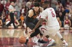 Arkansas forward Arlando Cook (5) defends Oklahoma State guard Lindy Waters III during a game Saturday, Jan. 27, 2018, in Fayetteville.