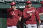 Arkansas head coach Dave Van Horn, left, and pitching coach Wes Johnson watch a scrimmage Saturday, Jan. 27, 2018, in Fayetteville.
