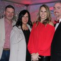 Scott and Jessica Bolle (from left) and Holly and Matt Hicks Paint the Town Red with the American He...