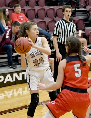 Bud Sullins/Special to Siloam Sunday Siloam Springs senior Kirsten Williams-Loftis looks for a pass Tuesday against Providence Academy.