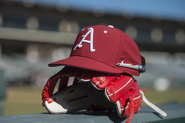 an-arkansas-hat-and-glove-sit-at-baum-stadium-during-practice-saturday-jan-27-2018-in-fayetteville