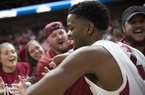 Arkansas Razorbacks guard Daryl Macon (4) greets fans after winning a basketball game, Saturday, January 27, 2018 at Bud Walton Arena in Fayetteville. Arkansas Razorbacks beat the Oklahoma State Cowboys 66-65.
