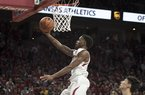Arkansas Razorbacks guard Daryl Macon (4) reaches for a layup during a basketball game, Saturday, January 27, 2018 at Bud Walton Arena in Fayetteville. Arkansas Razorbacks beat the Oklahoma State Cowboys 66-65.