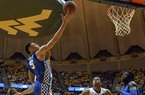 Kentucky forward Kevin Knox attempts a layup over West Virginia forward Sagaba Konate during the second half of an NCAA college basketball game Saturday, Jan. 27, 2018, in Morgantown, W.Va.
