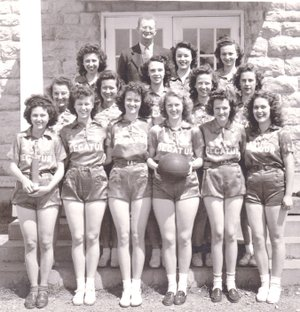 Westside Eagle Observer/SUBMITTED The 1945-46 Decatur High School senior girls' basketball team was photographed in front of the old high school (Decatur City Hall). Members included Ruby Austin (front, left), Barbara Jean Peek, Genevie Bredehoeft, Sally Hitch, Faye Dewey, Ruth Amos, Imogene Welch (row two, left), Mary Ackerman, Zelia Rae Sproies, Lila Miller, Kathryn Miller, Betty Bolch (row three, left), Barbara Vogelsang and Helen Martin. The school superintendent and girls' basketball coach, W.D. Barnes, is in the back row. Football and basketball was the topic of the first Decatur Historical Committee's movie night in the old gym (community room) in Decatur Jan. 22.