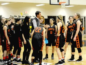 Westside Eagle Observer/MARK HUMPHREY Gravette coach Will Pittman explains tactics to the Lady Lions' basketball squad during a timeout. Pittman has guided the Lady Lions to a 16-5 record as of Thursday, including a 53-37 conference win over Lincoln in a rescheduled game played on Jan. 20.