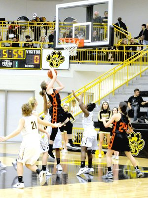 MARK HUMPHREY ENTERPRISE-LEADER/Gravette senior Kirstin Branscum scores the first basket of the game on a drive to the hoop. She had 16 points, but the Lady Lions lost on a last-second basket, 54-52, at Prairie Grove on Jan. 23.