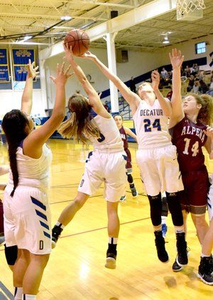 Westside Eagle Observer/MIKE ECKELS Destiny Mejia (Decatur 3) and Sammie Skaggs (Decatur 24) fight over an Alpena rebound during the Decatur-Alpena basketball contest Jan. 23 at Peterson Gym in Decatur.