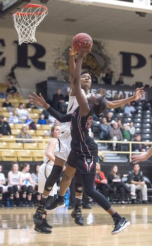 NWA Democrat-Gazette/BEN GOFF @NWABENGOFF Bentonville High's Maryam Dauda (30) attempts to block a shot by Springdale High's Marquesha Davis, who draws the foul, Tuesday at Tiger Arena in Bentonville.