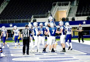 Photo Submitted Cole DelosSantos scores a touchdown for the Blue during the third quarter of the Blue-Grey All-American Bowl Game.