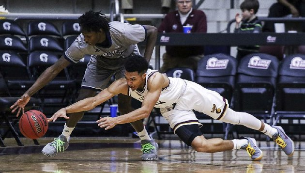 ualrs-jaizec-lottie-right-and-georgia-southerns-quan-jackson-scramble-for-a-loose-ball-thursday-at-the-jack-stephens-center-in-little-rock-the-trojans-lost-67-61-and-dropped-their-fifth-consecutive-game-in-the-sun-belt-conference