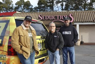 """FILE — Morning radio show hosts David Bazzel, Roger Scott and Tommy Smith pose for a photo outside a lingerie shop in Little Rock, Ark., where they hosted their show for KABZ-FM on Feb. 2, 2018. Last year, the shop sponsored the """"Babe Bracket"""" competition, in which listeners cast votes among 16 local female TV personalities. Bazzel said the competition isn't meant to demean women, but to give their work extra exposure. (AP Photo/Kelly P. Kissel)"""