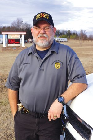 Lt. David Edwards of the Cave City Police Department stands in front of the school where he became a full-time resource officer last month after working part time since 2012. Edwards, 49, said he became interested in working for the school district after the mass shooting at Sandy Hook Elementary School in Connecticut.