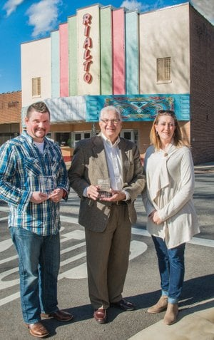 Main Street Searcy received two awards recently from the Main Street Arkansas program — the Best Downtown Public Improvement Award for work done around the Courthouse Square and Spring Street, and the Best Facade Restoration Award for work done at the historic Rialto Theater. Shown with the awards are, from left, Mike Parsons, director of the Searcy Parks and Recreation Department; Searcy Mayor David Morris; and Amy Burton, executive director of Main Street Searcy.