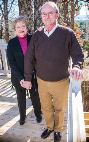 """David and Betty Snellings stand on the deck of their home in Russellville. The couple are being honored with Lifetime Achievement Awards and inducted into the Beaux Arts Academy of the River Valley Arts Center at a banquet scheduled from 6-9 p.m. March 1 at Lake Point Conference Center. """"They champion local artists in both the performing and visual arenas,"""" said Tanya Hendrix, executive director of the arts center. Betty is an artist and a retired art teacher."""