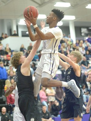 Fayetteville's Jon Conley (top) elevates over Bentonville High's Asa Hutchinson (left) for a shot attempt Friday at Bulldog Arena in Fayetteville. Visit nwadg.com/photos for more photos from the game.