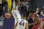 LSU's Aaron Epps (21) rejects a shot by Arkansas' Jaylen Barford (0) in the first half of an NCAA college basketball game in Baton Rouge, La., Saturday, Feb. 3, 2018. (Patrick Dennis/The Advocate via AP)