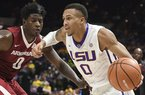 LSU's Brandon Sampson, right, drives to the basket in the first half of an NCAA college basketball game against Arkansas in Baton Rouge, La., Saturday, Feb. 3, 2018. Arkansas' Jaylen Barford, left, defends.