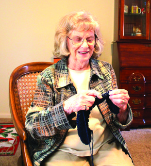 Knitting: Mary Jo Crosley knits a hat for Operation Gratitude, an organization that sends care packages to the military and their families.