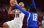 Arkansas' Devin Cosper (21) shoots over Kentucky's Amanda Paschal (12) during a game Monday, Jan. 29, 2018, in Fayetteville.