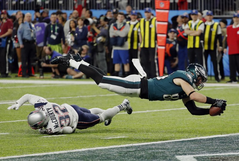6c6ff7bce74 Philadelphia Eagles tight end Zach Ertz (86) dives into the end zone over New  England Patriots free safety Devin McCourty (32) for a touchdown