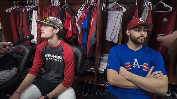 Blaine Knight (left) and Keaton McKinney, both Arkansas right hand pitchers, take questions Saturday, Jan. 27, 2018, in the locker room during Arkansas baseball media day at Baum Stadium in Fayetteville.