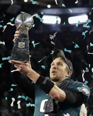 Philadelphia Eagles quarterback Nick Foles holds up the Vince Lombardi Trophy after the Eagles stunned the New England Patriots 41-33 in Super Bowl LII on Sunday in Minneapolis. It was the fi rst Super Bowl title for the Eagles.