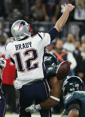 New England Patriots quarterback Tom Brady loses the ball when getting sacked by Philadelphia's Brandon Graham in the fourth quarter of Super Bowl LII. The fumble set up a field goal by Jake Elliott to help seal the Eagles' 41-33 victory.