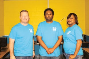 Captains: Project leaders, pictured from left, are Team IT captain William Clayton, project manager Christopher White and Team Paint captain Karen Cunningham. Brittany Williams/News-Times