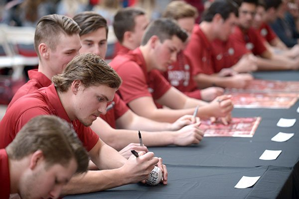 Arkansas baseball players sign autographs during the team's annual fan day on Saturday, Feb. 3, 2018, in Fayetteville.