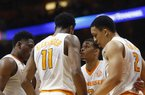 Tennessee guard James Daniel III (3) talks with teammates Admiral Schofield, left, Kyle Alexander (11) and Grant Williams (2) in the first half of an NCAA college basketball game Saturday, Feb. 3, 2018, in Knoxville, Tenn. (AP Photo/Crystal LoGiudice)