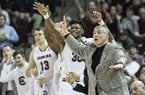 South Carolina head coach Frank Martin, right, communicates with players after a score during the first half of an NCAA college basketball game against Texas Tech, Saturday, Jan. 27, 2018, in Columbia, S.C. (AP Photo/Sean Rayford)