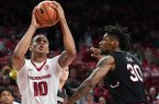 Arkansas' Daniel Gafford (10) prepares to shoot over South Carolina's Chris Silva during a game Tuesday, Feb. 6, 2018, in Fayetteville.