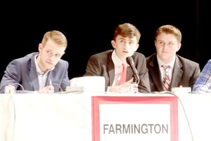 LYNN KUTTER ENTERPRISE-LEADER Coleman Warren, captain of Farmington's ACE team, answers one of the questions in the match Thursday at the Performing Arts Center in Farmington. Farmington won its match with 56 points.