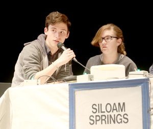 Lynn Kutter/Washington County Enterprise-Leader Avery Lang, a member of the Siloam Springs High School's Academic Competition in Education team, answers a question during a match on Jan. 25 at the Farmington Performing Arts Center. Brookie Hutto is seated next to Lang. Siloam Springs scored 12 points and came in third place in its match against Farmington (56 points) and Bentonville West (23 points). ACE is a regional competition that involves nine schools in Northwest Arkansas. The top seven teams advance to the championship matches on Feb. 21.