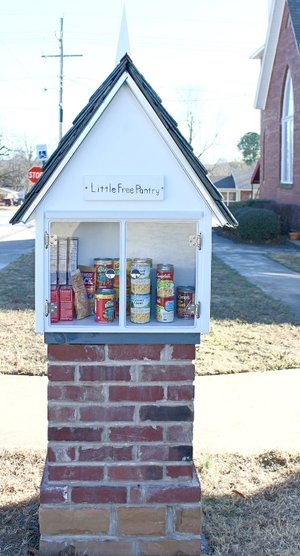 COURTESY PHOTO This side has the Little Free Pantry that provides non-perishable food items for those who need it.